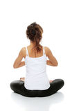 Woman doing yoga pose Royalty Free Stock Photography