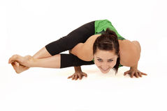 Woman doing yoga pose called eight angle pose Royalty Free Stock Photos