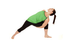 Woman doing yoga pose called revolved extended sid. Woman doing yoga bound revolved side angle Royalty Free Stock Image