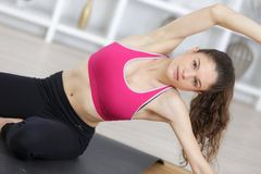 Woman doing yoga pose forth at windows exercising home Royalty Free Stock Photo