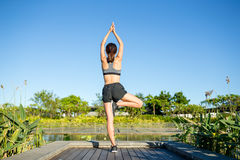 Woman doing yoga pose Royalty Free Stock Images