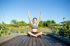 Woman doing yoga pose in park Stock Photo