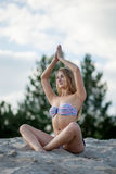 Woman doing yoga Stock Photo