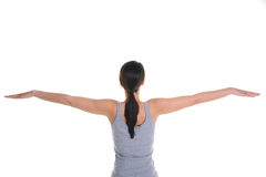 Woman doing yoga rear view Royalty Free Stock Photography