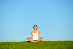 Woman doing yoga relaxing outdoor Stock Image