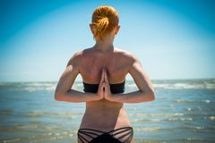 Woman doing yoga reverse namaste Royalty Free Stock Photo