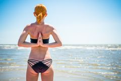 Woman doing yoga reverse namaste Stock Photo