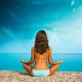 Woman Doing Yoga at the Sea Royalty Free Stock Photo