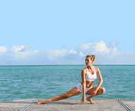 Woman doing yoga by the sea Royalty Free Stock Images