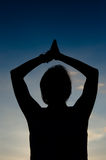 Woman doing yoga in silhouette Royalty Free Stock Image