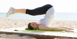 Woman doing yoga sitting Stock Photography