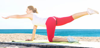 Woman doing yoga sitting Royalty Free Stock Images