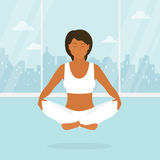 Woman is doing yoga and sitting in the lotus Stock Images