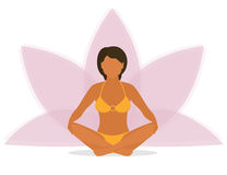 Woman is doing yoga and sitting in the lotus Royalty Free Stock Image