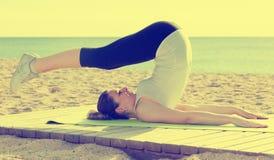 Woman doing yoga sitting Stock Photo
