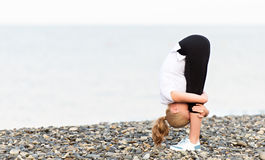 Woman doing yoga and sport exercises on  beach Royalty Free Stock Photography