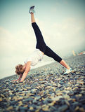 Woman doing yoga and sport exercises on  beach Stock Photography