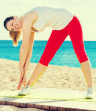 Woman doing yoga standing Royalty Free Stock Photo