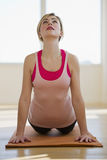 Woman doing yoga stretch in studio Royalty Free Stock Photo