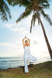 Woman Doing Yoga at Sunset Stock Photos