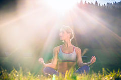 Woman doing yoga in sunset Royalty Free Stock Photography