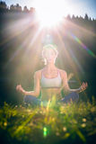 Woman doing yoga in sunset Stock Photography