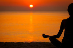 Woman doing Yoga at sunset Royalty Free Stock Photography