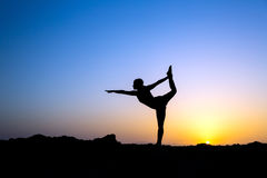 Woman doing yoga sunset silhouette Royalty Free Stock Photo