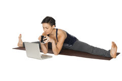 Woman Doing Yoga and Surfing the Web Stock Photography