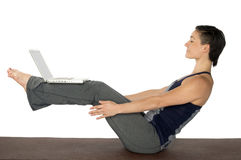 Woman Doing Yoga and Surfing the Web Stock Image