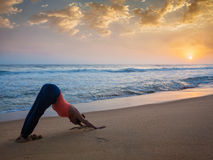 Woman doing yoga Surya Namaskar oudoors at tropical beach Royalty Free Stock Photo