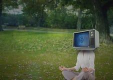 Woman doing yoga. tv head. Stock Photos