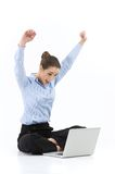 Woman doing yoga and using laptop. Royalty Free Stock Photos