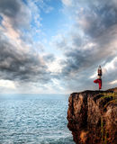 Woman doing yoga vrikshasana tree pose Stock Photos
