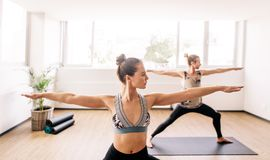 Fitness people doing yoga in health center Royalty Free Stock Photo