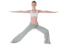Woman doing yoga, warrior/Virabhadrasana II pose Royalty Free Stock Photos