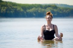Woman doing yoga in a water royalty free stock image