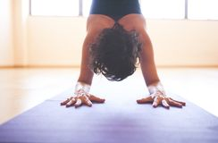 Woman doing yoga at wooden floor Royalty Free Stock Images