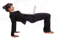 Woman doing Yoga at Work. Stock Image