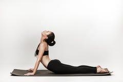 Woman doing yoga Stock Photos
