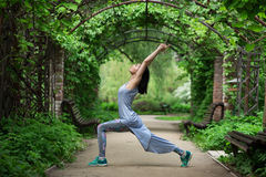 Woman doing youga in park Stock Images