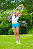 Woman doinng pilates exercises Royalty Free Stock Photo