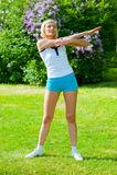 Woman doinng pilates exercises Stock Photos