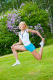 Woman doinng pilates exercises Royalty Free Stock Photos