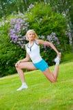 Woman doinng pilates exercises Royalty Free Stock Photos