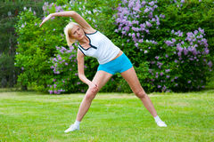 Woman doinng pilates exercises Royalty Free Stock Photography
