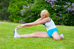 Woman doinng pilates exercises Stock Image