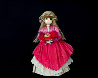 Woman doll, made of corn peel with black bg Royalty Free Stock Images