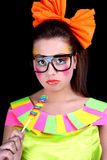 Woman in doll style with creative make-up Stock Image