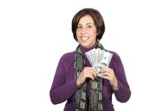 Woman with dollar bills. Woman with purple jacket and gray scarf with with dollar bills stock photo